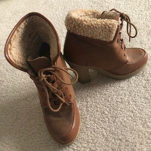 Rubber bottom heeled booties